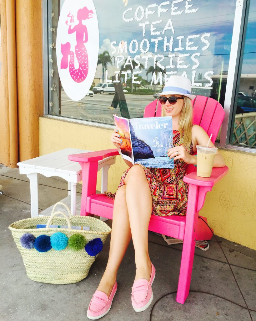 Kara Franker reading Conde Nast Traveler in Anna Maria Island