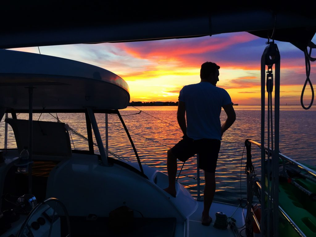 Jeremy Franker on a Catamaran at Sunset